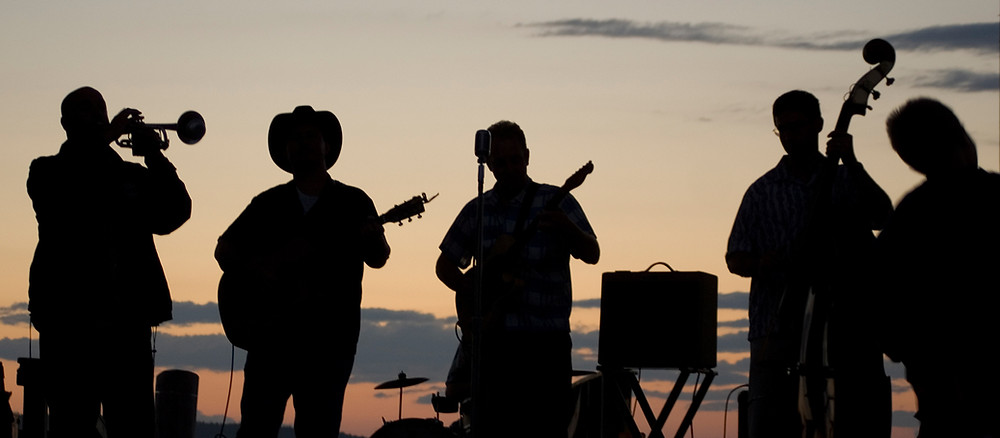 outdoor wedding band in front of the sunset