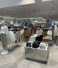 In-store merchandising with lots of neutral tones.