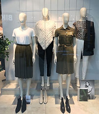 Window display with the trendy colours white and khaki.
