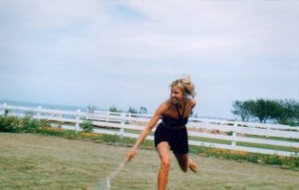 My beautiful mom playing tennis near Lake Ontario.