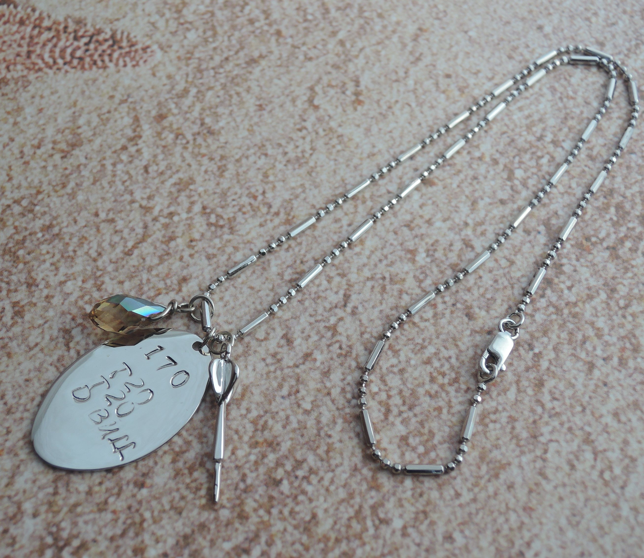 Rhodium plated hand stamped oval dis