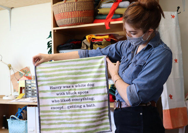 Ready to get out of the tub and dry off? This towel will hang behind Harry and resembles the green and white one in the book except for the beloved bit of text we added.