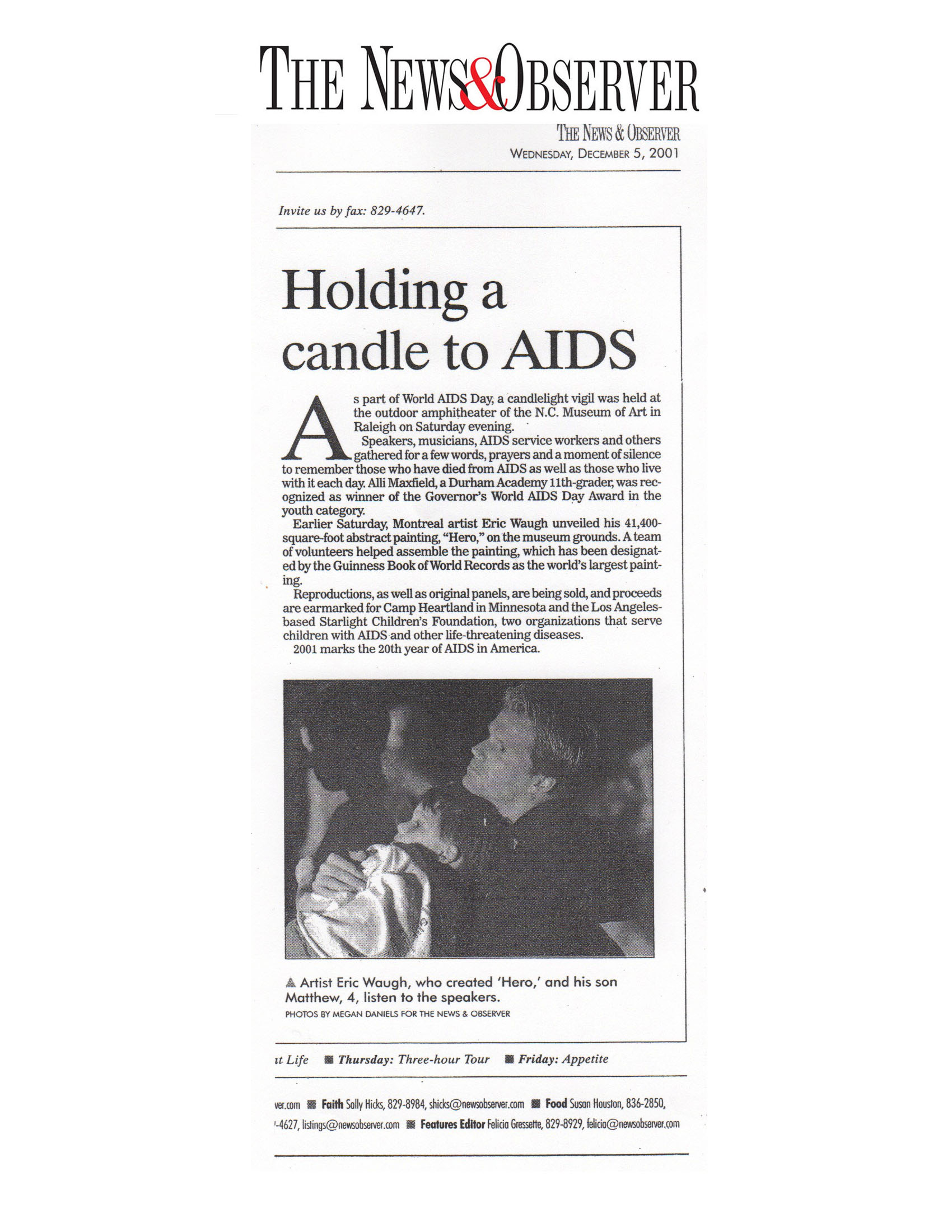 the news and observer holding a candle.jpg