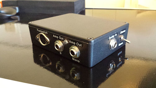 Stereo/Mono Guitar Input/Amp Output Interface with MIDI in/out or Thru Connections