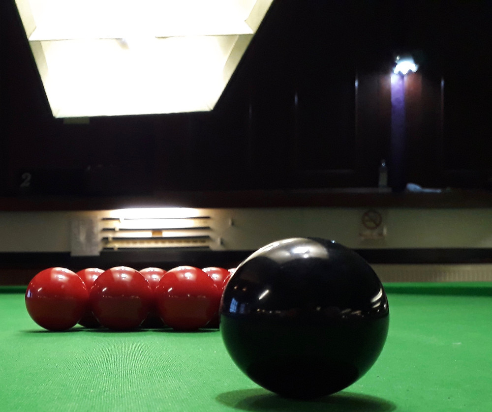 Snooker table with black and red balls