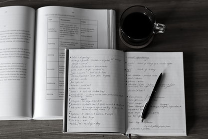 copy of a phd thesis, coffee and note-taking