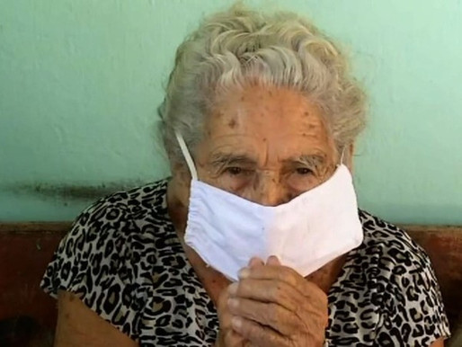 108-year old woman gives her COVID-19 vaccine to a younger person