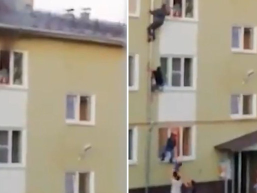 """Neighbours form a """"human chain"""" to save children in a fire"""