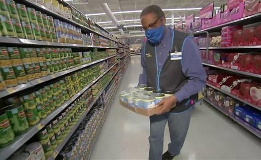 School principal works nights in a supermarket to help students