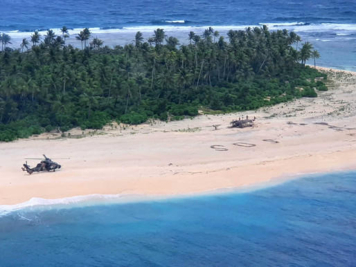 3 men are rescued from a desert island after writing SOS in the sand