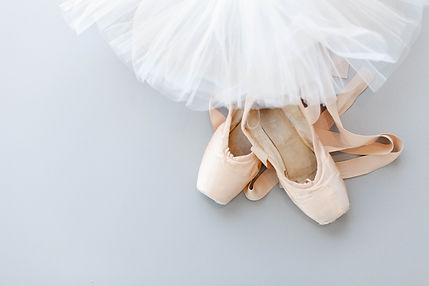 Ballet pointe shoes and white tutu skirt