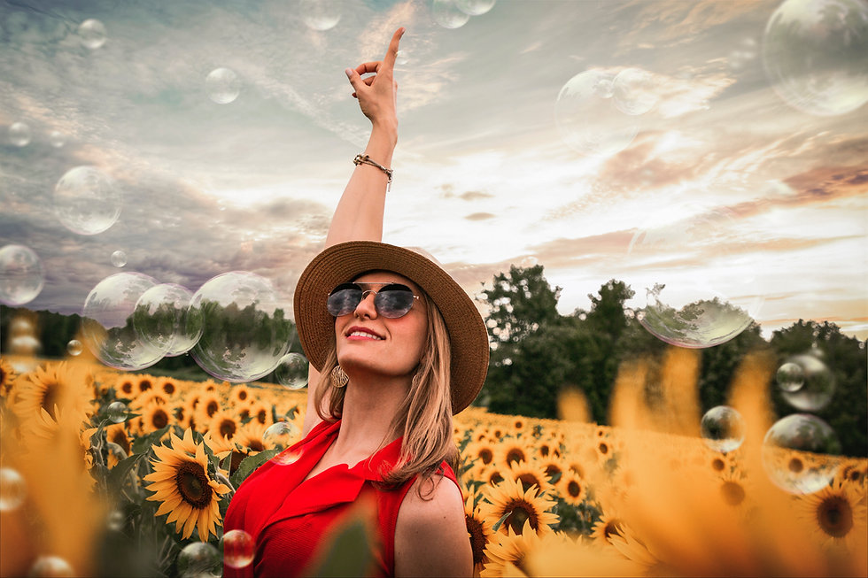 woman-surrounded-by-sunflowers-raising-h