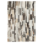 Tapis cuir patchwork gris.png