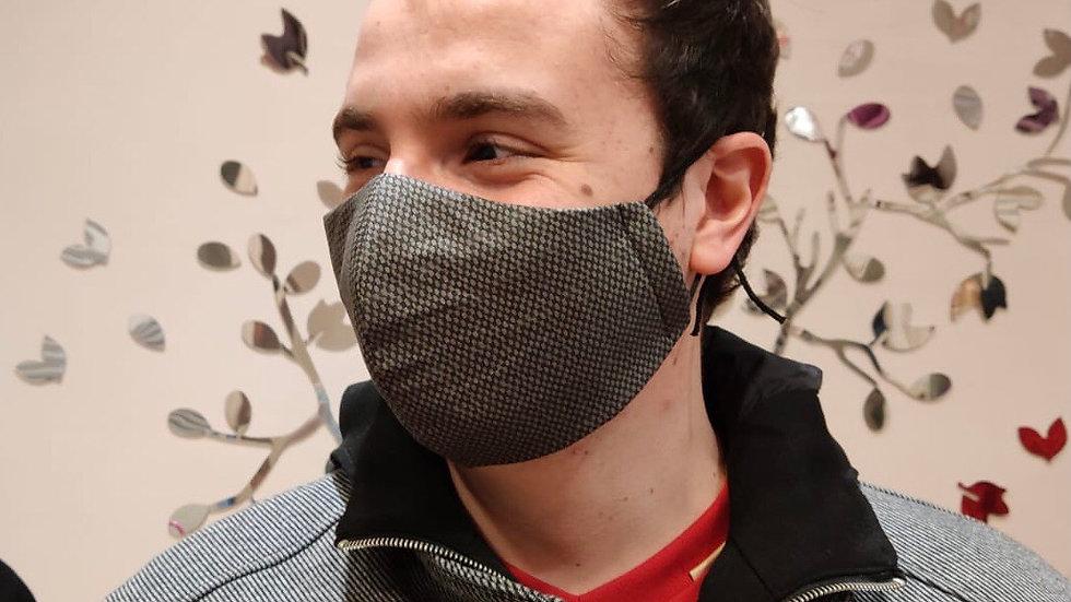 Mascarilla jaspeada gris y negra. Tejido de algodón orgánico con acabado hidrófu