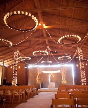 Rustic chandeliers adorn the ceremony