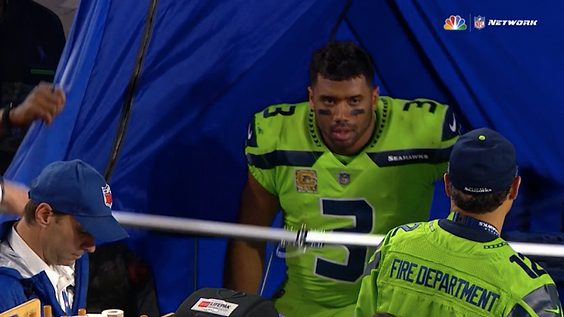 Russell Wilson in Tent.png
