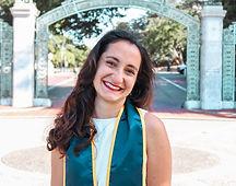 Yagmur Halezeroglu smiling outside with a green sash around her shoulders