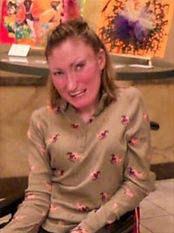 Amanda Lojeski smiling wearing a grey patterned shirt