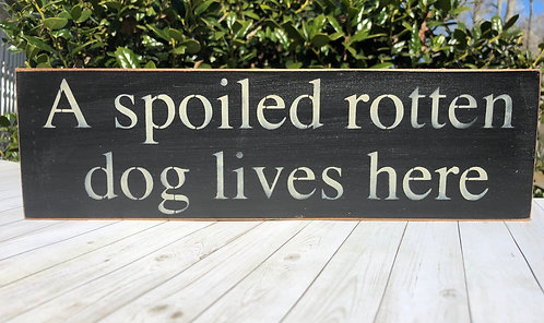 A Spoiled Rotten Dog Lives Here