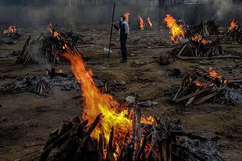 Bodies burning onpyres in East Delhi
