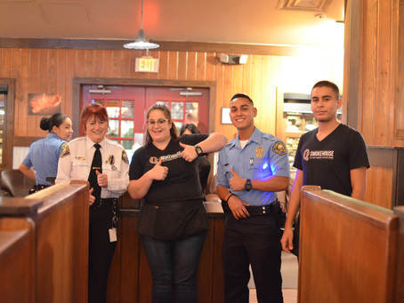 Local Law Enforcement Serves Customers at Q Smokehouse