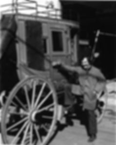 Man with one of our Concord stagecoaches for sale