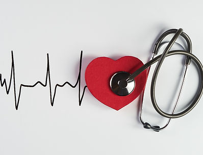 Medical stethoscope and red heart with c