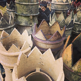 Victorian chimney pots stacked in a reclamation yard