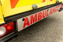 Backside view of yellow ambulance car si