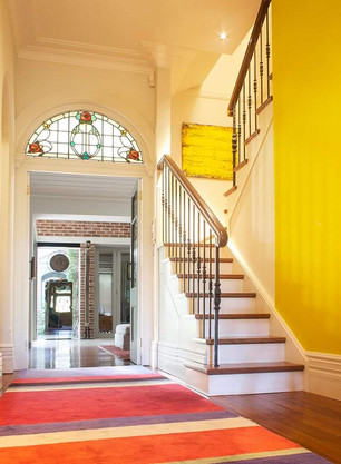 Grand hallway staircase design by Budget Stairs