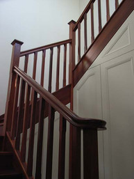 stained timber staircase design with timber balustrades by Budget Stairs