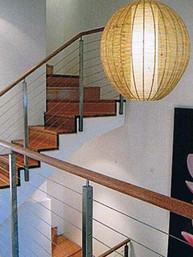 white and timber concealed string staircase in Sydney image