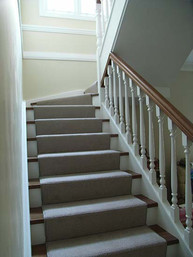 Timber and white balustrade and staircase design by Budget Stairs