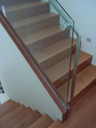 timber staircase with glass balustrade image