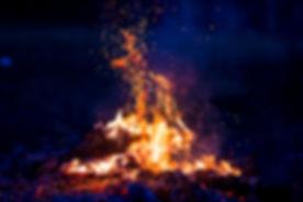 Burning wood at night. Campfire at touri
