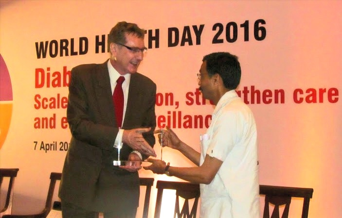 Dr. Ashish receiving WHO 'Public Health Champion' Award from WHO India cheif Mr. Henk Bekedam