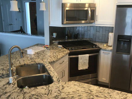 Granite Cold Spring Countertops and White Cabinets