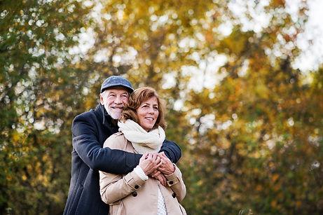 senior-couple-standing-in-an-autumn-nature-WNR3ZX7_edited.jpg