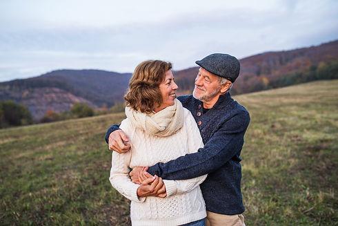 senior-couple-hugging-in-an-autumn-natur