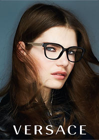 Young Attractive women wearing Versace Glasses