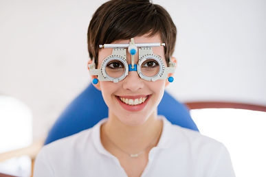 woman-doing-eye-test-with-optometrist-in