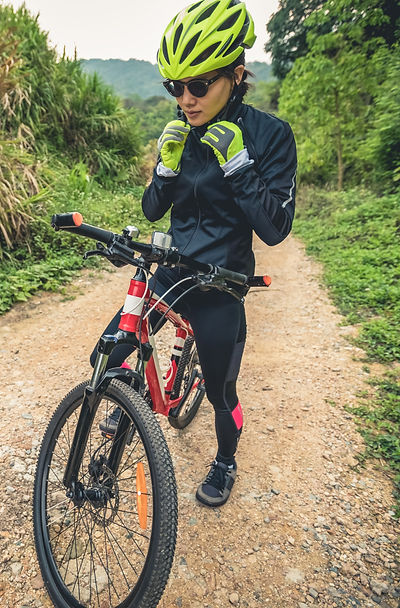 Women out on her bike wearing sports glasses
