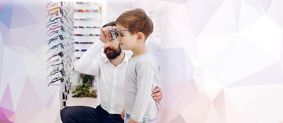 Boy having trying on glasses