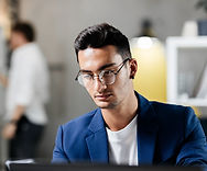 man wearing glasses at work.jpg