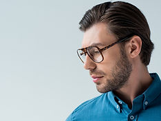 serious-young-man-in-stylish-eyeglasses-isolated-o-SJBBNDQ_edited.jpg