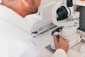 doctor-operating-an-optical-machine-95DU