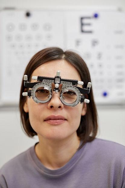 Woman wearing trail frames after eye test