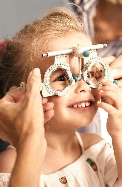 Child having her eyes tested