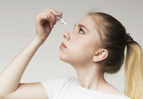 Women using eye drops for dry eyes