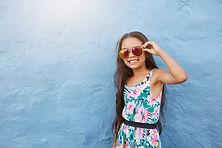little girl wearing sunglasses